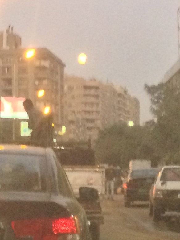 Nearly full moon above Cairo's congested streets.