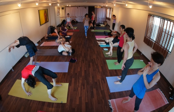 Kaz Castillo assists Veronique Tan at Spirit Yoga Morning Mysore